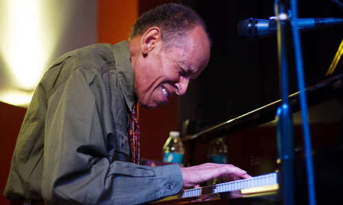 Charles Lewis plays the piano on Sept. 21, for his 81st birthday party at the Nash. (Courtney Pedroza/DD)
