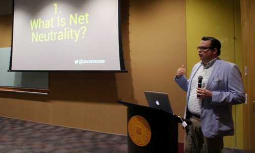 Andrew Pilsch, assistant professor of the ASU Schools of Letters and Sciences, gives a presentation on net neutrality at the New York Times Cafe, held at the ASU Downtown Phoenix campus Wednesday, Sept. 10, 2014. (Miguel Otárola/DD)