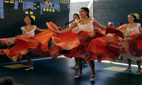 Primavera Folklorico Dance Company performs at the Harmon Library in Phoenix on Oct. 11. Primavera is a dance group that performs Mexican regional dance representing the people of Mexico. (Caitlin Bohrer/DD)