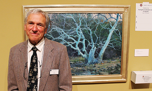 Lee Chimiel stands by his painting, a part of The West Select exhibit at the Phoenix Art Museum. (Taylor Bishop/DD)