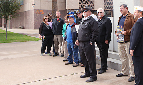 Veterans rally at the state capitol on Tuesday, Jan. 27 to ask Ariz. Governor Dough Ducey to invest in more veterans programs. Ducey withdrew his budget proposal last week to cut just over $900,000 from the Veterans Family Relief Fund. (Alejandro Salazar/DD)