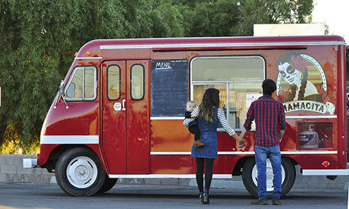 Mitch Wiewel, Itzel Arvizu and their daughter Meadow in front of their food truck, Tuesday, December 8, 2015, in Phoenix.