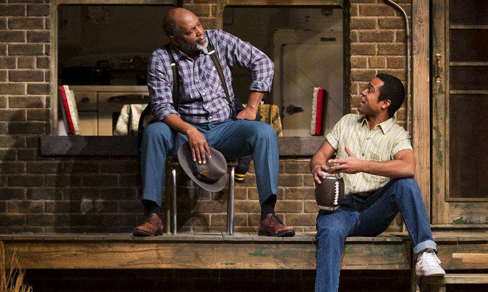 """David Alan Anderson, left, plays Troy Maxon alongside Edgar Sanchez, playing Cory Maxson during a dramatic scene in """"Fences."""" The play runs in Phoenix until Feb. 28. (Courtesy Tim Fuller)"""
