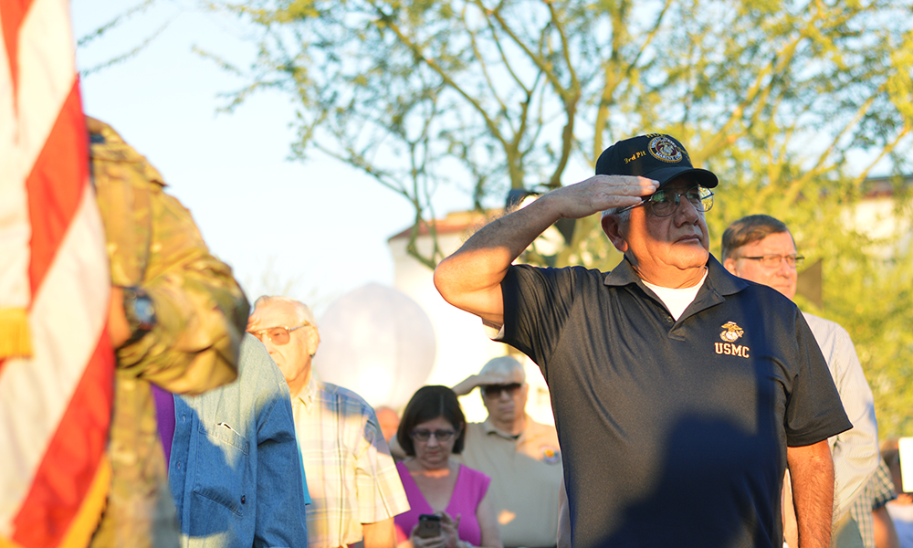 A Marine Corps veteran salutes as the Color Guard procession marches past. (Katelyn Finnegan/DD)