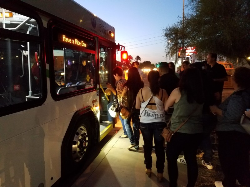 Commuters board a city bus at the kickoff event for Phoenix's new late night bus routes. (Jeff Brooks/DD)