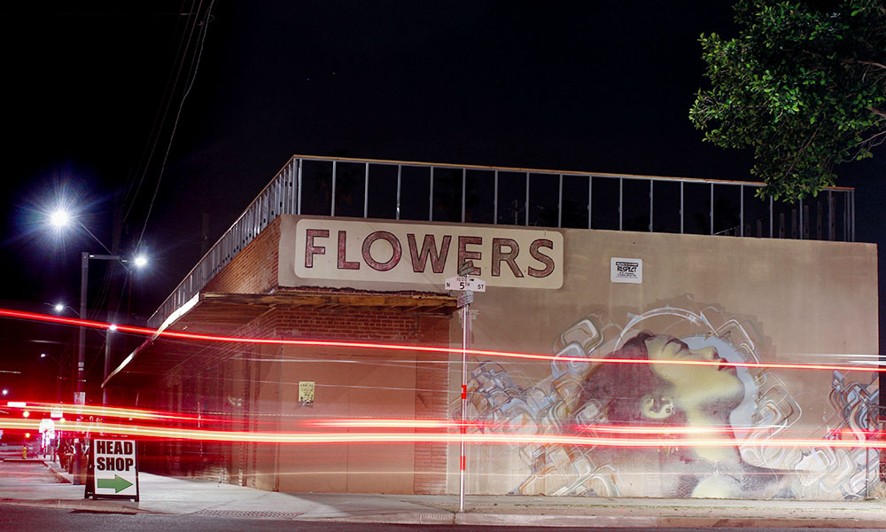 The future of Augustine Kofie's mural on the Flowers building is under debate in the latest perceived clash between artists and developers in downtown Phoenix. (Nicole Neri/DD)